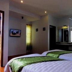 Отель Starfruit Homestay Hoi An 2* Улучшенный номер с различными типами кроватей фото 2