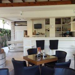 Апартаменты Tianis Apartments гостиничный бар