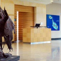 Отель Le Méridien St Julians Hotel and Spa Мальта, Баллута-бей - отзывы, цены и фото номеров - забронировать отель Le Méridien St Julians Hotel and Spa онлайн интерьер отеля фото 2