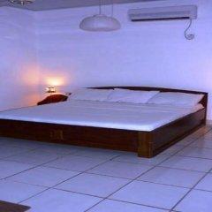 Отель Brenu Beach Lodge Стандартный семейный номер с двуспальной кроватью фото 6