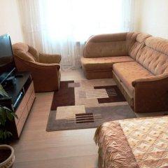Апартаменты Comfort Minsk Apartment Минск комната для гостей фото 3