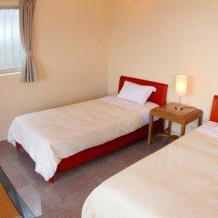 Отель Cottage Seaside Центр Окинавы комната для гостей фото 5