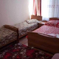 Гостиница Уют Стандартный семейный номер разные типы кроватей фото 3