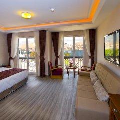 Askoc Hotel 3* Улучшенный семейный номер с двуспальной кроватью фото 4