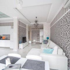 Апартаменты Royal Apartments Minsk Минск комната для гостей фото 5