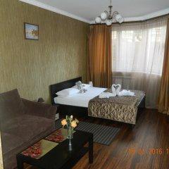 Мини-Отель Уют Стандартный семейный номер с различными типами кроватей фото 3