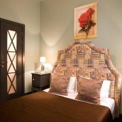 Мини-Отель Амстердам Улучшенный номер двуспальная кровать фото 4
