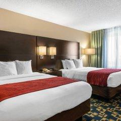 Отель Comfort Inn & Suites near Universal Orlando Resort комната для гостей фото 6