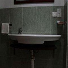 Апартаменты Calabash Green Executive Apartments Тема ванная