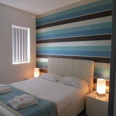 Отель 115 The Strand Suites комната для гостей фото 3
