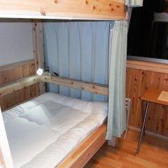 Отель Guesthouse Yakushima 2* Кровать в женском общем номере фото 3
