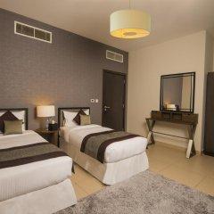 Отель Nassima Tower Hotel Apartments ОАЭ, Дубай - отзывы, цены и фото номеров - забронировать отель Nassima Tower Hotel Apartments онлайн комната для гостей фото 3