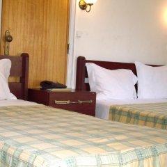 Отель Pensao Residencial Camoes 2* Стандартный номер с различными типами кроватей фото 5