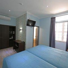 Отель Pensao Praca Da Figueira Стандартный номер фото 7