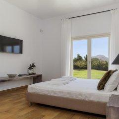 Отель Belvedere Beachfront Villa комната для гостей