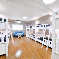 Отель Khaosan World Asakusa Ryokan Кровать в общем номере фото 11