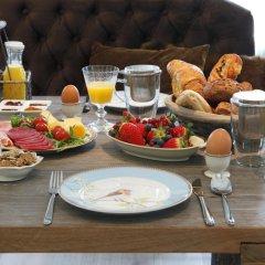 Отель Christie's Huiskamer питание