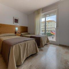 Отель Apartamentos Loto Conil Испания, Кониль-де-ла-Фронтера - отзывы, цены и фото номеров - забронировать отель Apartamentos Loto Conil онлайн комната для гостей фото 2