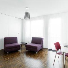 Апартаменты Ema House Serviced Apartments Seefeld Цюрих комната для гостей фото 3
