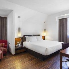Отель NH Milano Touring 4* Улучшенный номер разные типы кроватей фото 17
