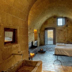 Отель Sextantio Le Grotte Della Civita 4* Улучшенный номер фото 5