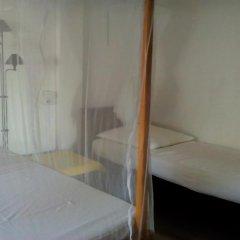Отель Roshini Inn Апартаменты с различными типами кроватей