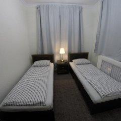 Гостиница Майкоп Сити в Майкопе отзывы, цены и фото номеров - забронировать гостиницу Майкоп Сити онлайн комната для гостей фото 2