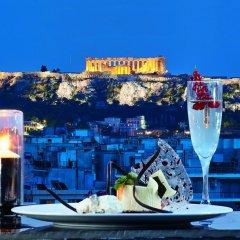 Отель Wyndham Grand Athens Греция, Афины - 1 отзыв об отеле, цены и фото номеров - забронировать отель Wyndham Grand Athens онлайн приотельная территория фото 2