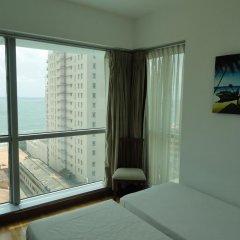 Отель Sea View Monarch Apartment Шри-Ланка, Коломбо - отзывы, цены и фото номеров - забронировать отель Sea View Monarch Apartment онлайн комната для гостей фото 2