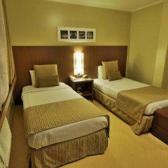 Hotel Deville Business Curitiba сейф в номере
