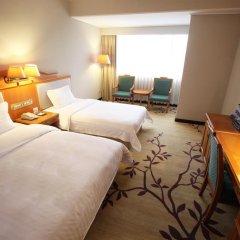 Guangzhou Hotel 3* Стандартный семейный номер с разными типами кроватей фото 2