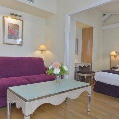 Отель Suites Unic Renoir Saint-Germain Франция, Париж - отзывы, цены и фото номеров - забронировать отель Suites Unic Renoir Saint-Germain онлайн комната для гостей фото 5