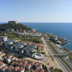 Отель Luxury Apt in Konak Sea Side with a Sea front view and a private beach пляж фото 2