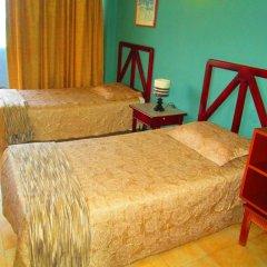 Отель Tiuna Колумбия, Сан-Андрес - отзывы, цены и фото номеров - забронировать отель Tiuna онлайн комната для гостей фото 5
