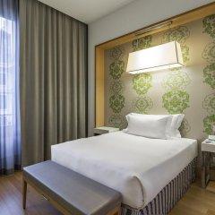 Отель NH Milano Touring 4* Стандартный номер разные типы кроватей фото 23