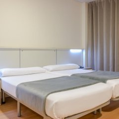 Отель Vertice Roomspace Madrid 3* Улучшенный номер с 2 отдельными кроватями