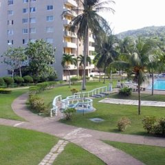 Отель Beach-side condos at Turtle Beach Towers фото 2