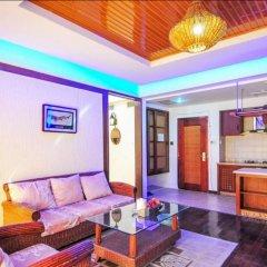 Апартаменты Fenghuang Rujia Holiday Apartments - Sanya Bay Branch комната для гостей фото 2