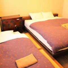 Отель K's House Tokyo Oasis Кровать в общем номере фото 3