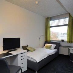 Отель Primestay Apartmenthaus Zurich Seebach Швейцария, Цюрих - отзывы, цены и фото номеров - забронировать отель Primestay Apartmenthaus Zurich Seebach онлайн комната для гостей фото 3