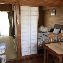 Отель Crystal Inn Onna Центр Окинавы комната для гостей