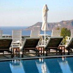 Nikos Villas Hotel in Oia Santorini 3* Студия с различными типами кроватей фото 3