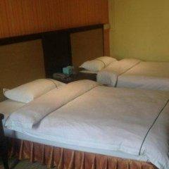 Отель Zhongshan Guzhen Yuyuan Business Inn комната для гостей фото 4