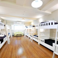 Отель Khaosan World Asakusa Ryokan Кровать в общем номере фото 5