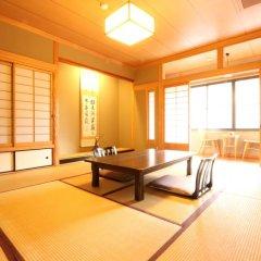 Отель Marucho Ryokan Минамиогуни комната для гостей