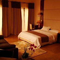 Отель L'Orchidee Hotel Республика Конго, Пойнт-Нуар - отзывы, цены и фото номеров - забронировать отель L'Orchidee Hotel онлайн комната для гостей фото 3
