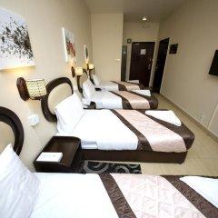 Grand Sina Hotel Стандартный семейный номер с различными типами кроватей фото 12