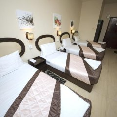 Grand Sina Hotel Стандартный семейный номер с различными типами кроватей фото 9