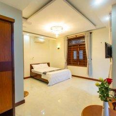 Отель MiMi Ho Guesthouse Номер Делюкс с различными типами кроватей фото 3