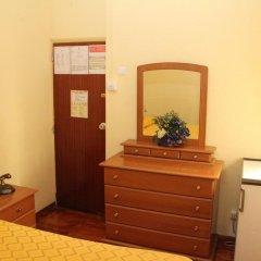 Отель Pensao Residencial Flor dos Cavaleiros 2* Стандартный номер с различными типами кроватей фото 3